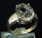 Oval faceted crystal ring.