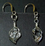 Clear double terminated crystal earrings.