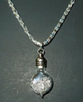 Diamonds in a genie bottle necklace.