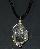 Clear quartz crystal necklace.