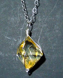 Golden healer crystal necklace.